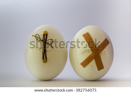 2 broken eggs, white background with selective focus - stock photo