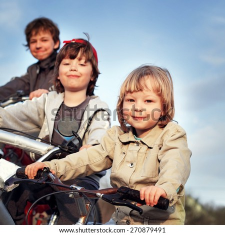 brothers ride on bikes - stock photo