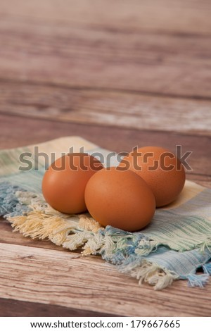 3 Brown Eggs in a Rustic Setting - stock photo