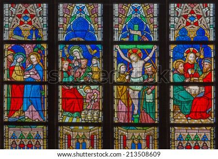 BRUGES, BELGIUM - JUNE 12, 2014: The New Testament scenes on windowpane in St. Salvator's Cathedral (Salvatorskerk) by stained glass artist Samuel Coucke (1833 - 1899)  - stock photo