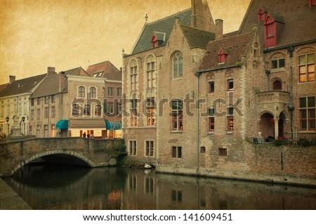 Bruges historic centre, Belgium. Photo in retro style. Paper texture. - stock photo