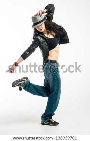 Brunett dancer. Woman dancing in a studio - stock photo