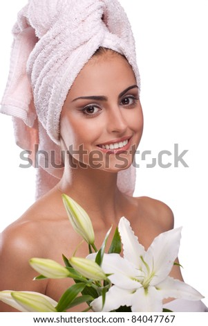 brunette spa woman in towel on head with flowers