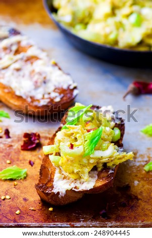 bruschetta with celery and eggs .style vintage. selective focus