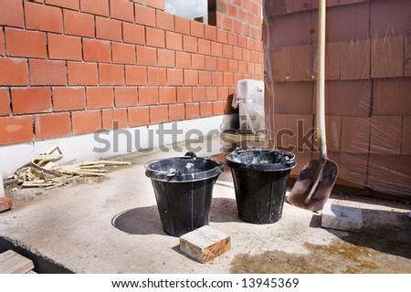 bucket and shovel.  Under construction. - stock photo