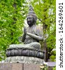 Buddhist statue at the Senso-Ji temple, Tokyo. It is said to be the oldest buddhist temple in the country, built in 645 C.E. - stock photo