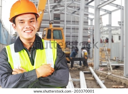 Builder construction worker or foreman with safety protective equipment  standing on  location site - stock photo