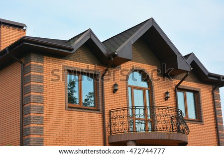 Building Brick House Construction With Different Types Of Roof Design And  Metal Balcony