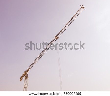 Building crane in a construction site over blue sky vintage