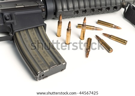 223 Bullets with M16 style Military Assault Rifle isolated on white background - stock photo