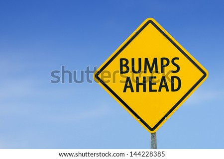 """""""BUMPS AHEAD"""" traffic sign with blue sky - stock photo"""