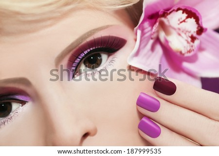 Burgundy and purple makeup and nails on the girl with Orchid.