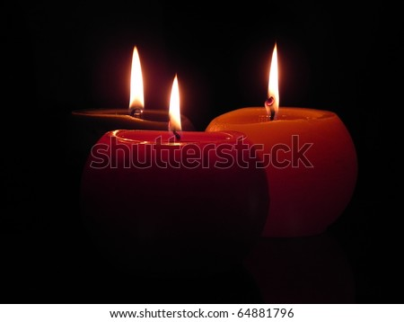 Burning candles in the dark