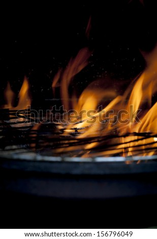 burning grill, outdoors ,fire flame,  - stock photo