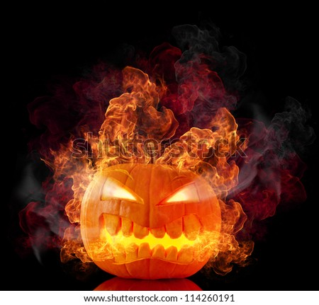 Burning halloween pumpkin, isolated on black background - stock photo