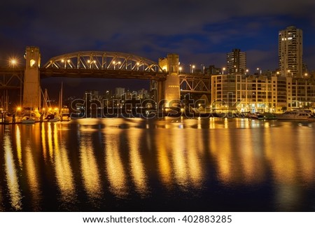Burrard Bridge Night, Vancouver. The view from Granville Island of the historic Burrard Street Bridge on Vancouver's False Creek. British Columbia, Canada.                   - stock photo