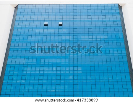 Business building with blue windows.