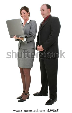 Business Couple With Laptop Computer. Shot in studio over white.