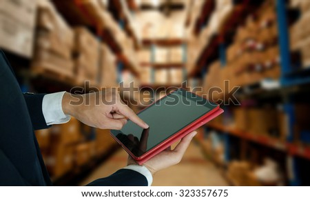 business idea concept , Businessman hand on touchscreen tablet ,retail - stock photo