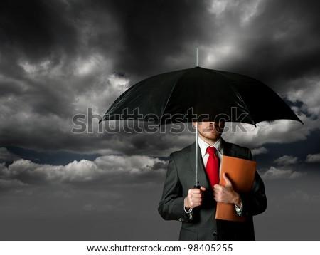 business man and umbrella - stock photo