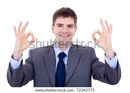 Business man giving OK gesture over white background - stock photo