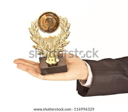 business man holding a trophy aloft - stock photo