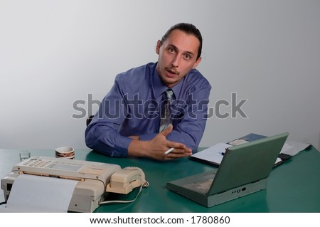Business man in his office - stock photo
