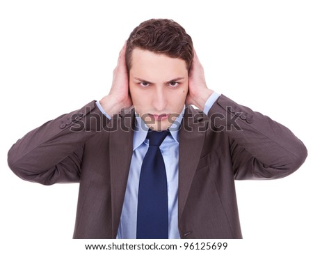 business man in the Hear no evil pose on white background. young businessman covering his ears with his hand