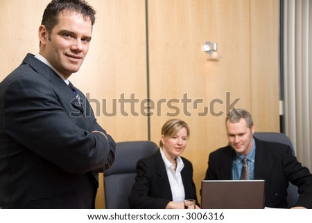3 business people with man in foreground
