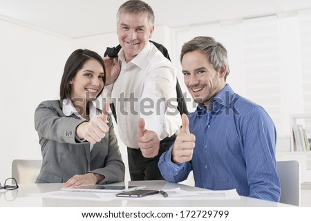 business team at office showing thumb up - stock photo
