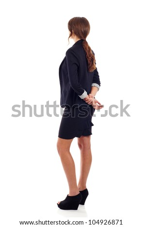 Business woman from the back, looking at something isolated over white background