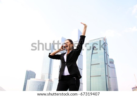 business woman on the phone at modern building - stock photo