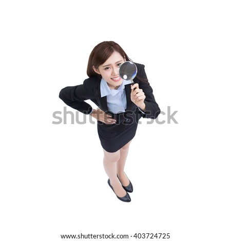 business woman uses magnifying with white background, high angle view, asian beauty - stock photo