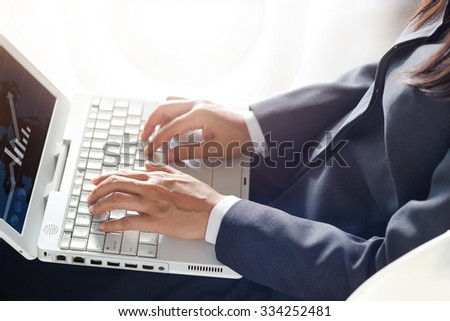 business woman using laptop computer on airplane