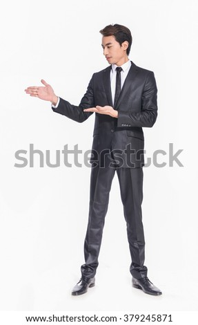 business young man touching an imaginary screen or button on white background - stock photo