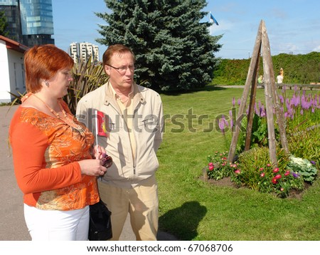Businessman and businesswoman watching project - stock photo