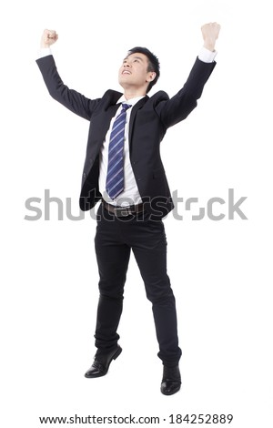 Businessman cheering with arms up - stock photo
