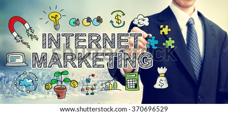 Businessman drawing Internet Marketing concept above the city - stock photo