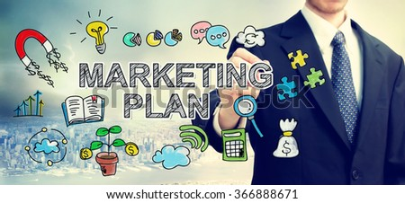 Businessman drawing Market Plan concept above the city - stock photo