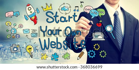 Businessman drawing Start Your Own Website concept above the city - stock photo