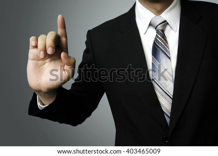 businessman finger click, businessman pressing button with contact on virtual screens - stock photo