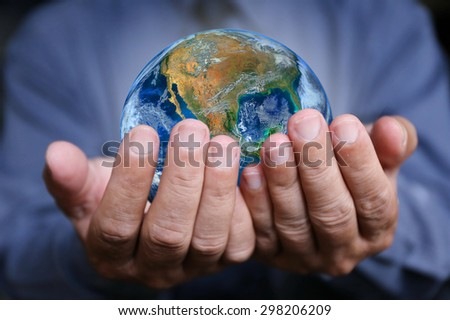 businessman hand hold the earth , politics or environmental conservation Earth image courtesy of Nasa - stock photo