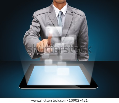 businessman hands use tablet computer and virtual icons - stock photo