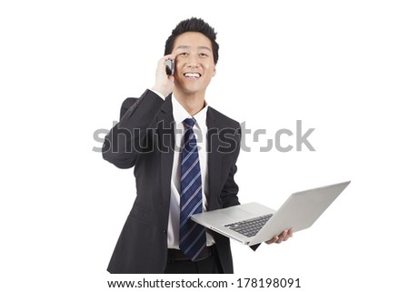 Businessman Holding Laptop Computer And Phone