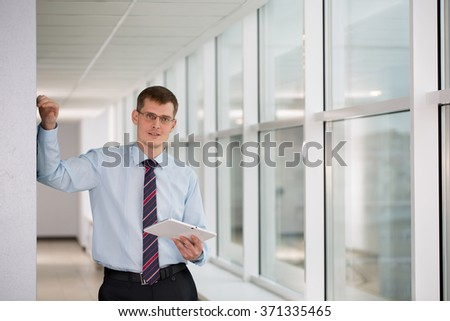 businessman in an office in a good mood