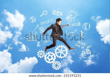 businessman jump with  business symbol sketch background on blue cloudy sky. - stock photo