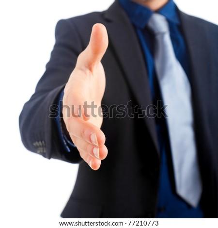 Businessman offering a handshake - stock photo