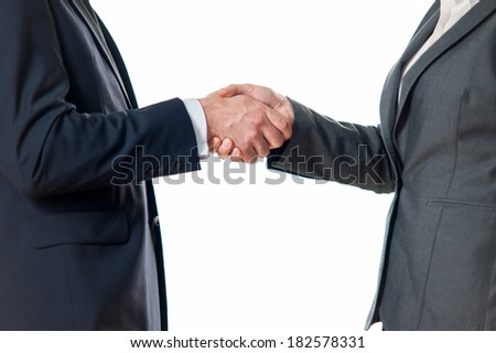 Businessman or man shaking hands with a businesswoman or woman colleague making a business deal on white background - stock photo