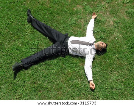 Businessman relaxing.After a hard day's work, he can finally rest. - stock photo
