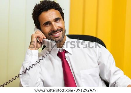 Businessman talking on the phone  - stock photo